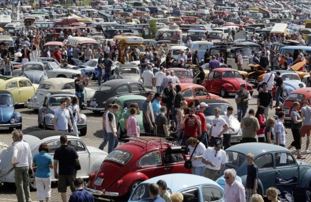 "People look at vintage Volkswagen cars during 29th annual ""Kaefer"" meeting in Hanover"