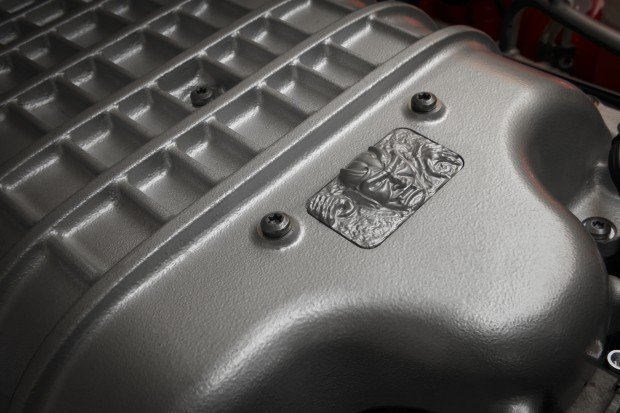 Custom Demon diecast emblem located on the cover the 6.2-liter s