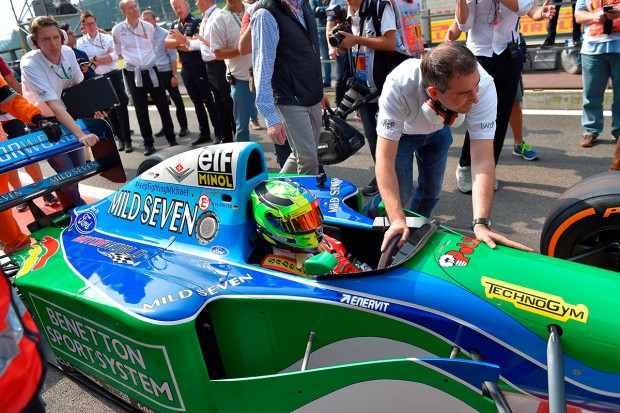 Mick Schumacher, German racing driver and son of seven-time Formula One champion Michael Schumacher, sits inside a Benetton B194 car before driving demonstration laps on the occasion of Michael Schumacher's 25th first Formula One victory, at the Spa-Francorchamps circuit in Spa on August 27, 2017, ahead of the Belgian Formula One Grand Prix. / AFP PHOTO / LOIC VENANCE